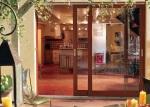 baie vitrée ton bois coulissante à galandage - Solabaie
