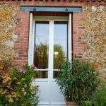 Porte-fenêtre bois blanche posée par votre installateur D'Eco Ouest à Chatou