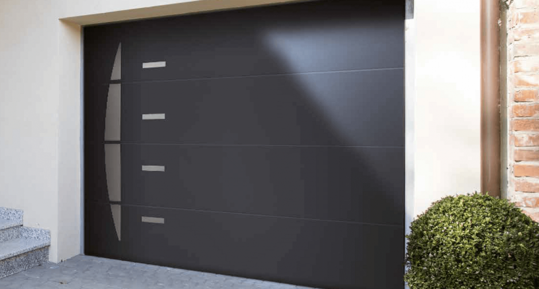 Porte de garage motoris e portes de garage sur mesure for Porte de garage sectionnelle soprofen