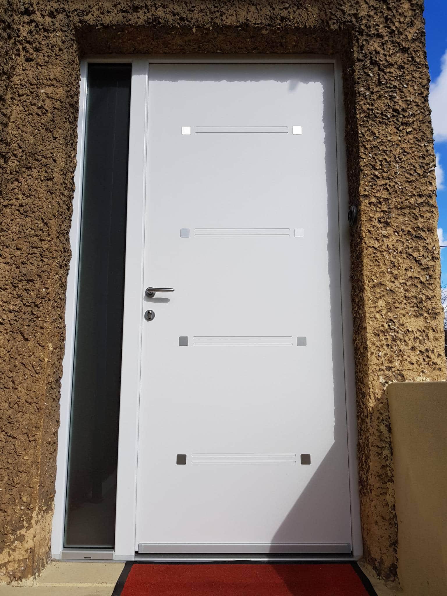 Les r alisations solabaie le havre porte d entr e pvc for Porte de garage le havre